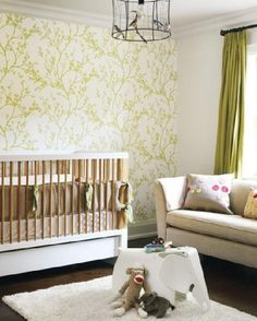 Taupe and green nursery.   Maybe a taupe wall with a print on it.  Like the couch and bedding....