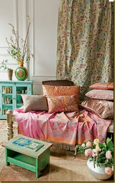 Boho, shabby chic with a little cottage inspiration. Pretty eclectic stule.
