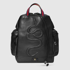 GUCCI Snake Embossed Drawstring Backpack. #gucci #bags #leather #backpacks #