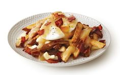 Eggs Benedict Poutine with French fries,  gravy, cheese curds