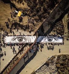 a dreamer's eyes, on either side of trump 's terrible wall (via @jr) jr is an amazing artist currently working worldwide.