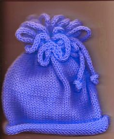 I knit so many charity hats, I need a little variation on the theme sometimes. this pattern has been around our knitting guild for a whil. Christmas Stocking Pattern, Christmas Stockings, Monster Slippers, Baby Ballet, Knitting Machine Patterns, Baby Ornaments, Elf Hat, Knitted Flowers, Twist Headband