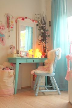 pretty little girl's bedroom with dressing table. I love the aqua curtains.