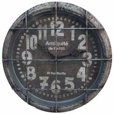 """Antiqued metal wall clock with a cage-style overlay.    Product: Wall clock   Construction Material: Metal  Color: Weathered gray  Accommodates: Batteries - not included   Dimensions: 13.5"""" Diameter x 3.5"""" D"""