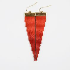 Fireball // The boldest earrings we've loomed yet.  Loom beaded earrings. Handmade by the Pigment Project. Minimalist, geometric, elegant, contemporary, native, colorful, bright, and chic jewelry.  Pigmentproject.com