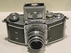 The real first 35mm format SLR was the Ihagee Kine Exakta, produced in 1936 in Germany, which was fundamentally a scaled-down Vest-Pocket Exakta. This camera used a waist-level finder.