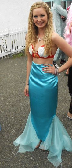 DIY Mermaid Costume. I used a glue gun, pretty shells and a sewing machine for the tail!