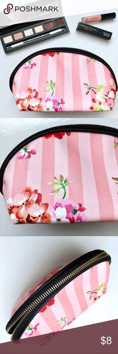"NWT Ulta Floral Stripe Cosmetic Bag / Clutch This fun floral catch is sure to steal the show. Flirty striped and floral pattern with semi-circle zipper opening. Brand new with tag, lined, no pockets. Zipper top with wide bottom. Never used in perfect condition. Makeup not included.   Measurements:  Length 9 1/2"" Height 5 1/2"" Depth (bottom) 4"" Ulta Bags Cosmetic Bags & Cases"