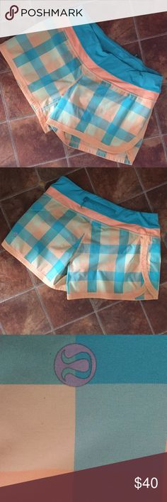 Lululemon Groovy Speed Shorts Plaid Retired Groovy Plaid Speed Shorts in Tang Lagoon Orange and Teal.  In Excellent worn condition.  Features two way stretch, zipper back pocket and draw string waist. lululemon athletica Shorts