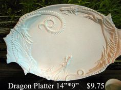 Hey, I found this really awesome Etsy listing at http://www.etsy.com/listing/79777902/gorgeous-dragon-platter-ceramic-bisque