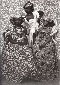 this is portrait was taken by Seydou Keita in Bamako, 1935. I like the patterns in the background and on the cloths.