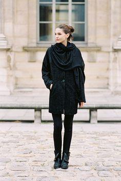 All-black street style! Black coat, drapey black scarf, black leggings, ad ankle boots