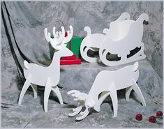Make tabletop reindeer using cardboard or foam board and a downsized template from the yard sized wooden ones. Additional links: https://www.etsy.com/listing/16860404/set-of-2-white-foam-reindeer-and-foam?ref=related-2 and https://www.etsy.com/listing/114770371/laser-cut-wooden-reindeer-rudolph-model?ref=sr_gallery_5&ga_search_query=wooden+reindeer&ga_view_type=gallery&ga_ship_to=US&ga_search_type=all&ga_facet=wooden+reindeer