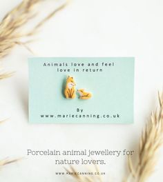 Handmade mother fox and her cub earrings made from recycled porcelain clay by Marie Canning. Perfect woodland animal inspired jewellery for nature lovers. Decorated with a soft orange glaze and fine gold details upon sterling silver backs. Part of my animal inspired earring collection.