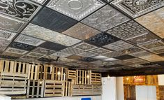 Faux tin and real tin ceiling tiles can be combined with a variety of textures and styles to create this eclectic, rustic look. It's also known as a quilted ceiling. Courtesy of Taco del Sol in Missoula, MT. Faux Tin Ceiling Tiles, Tin Tiles, Pallet Ceiling, Luxury Penthouse, Ceiling Light Design, Rustic Kitchen Design, Interior Architecture, Interior Decorating, Speakeasy Bar