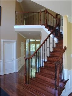 I like how simple this is with matching dark wood on floors & rails