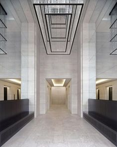 Entrance hall of one of the office blocks of the Upper Eastside Berlin project by GMP Architekten. Beautiful classical hall with clever use of mirrors to optically enlarge the space.: