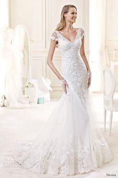 Nicole Spose Bridal 2015, style 43 niab15012iv v neck cap sleeves trumpet wedding dress. Not my style, but I'm a sucker for v-necks.