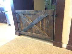 Rustic barn door doggy/child gate. Can be made in a finish to match your home along with dimension that fit your space best! Hand crafted in Southern California.