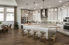 The neutral palette of The Chatman in Phoenix, AZ creates a calm atmosphere. The use of glass subway tiles is an elegant way to incorporate clean lines and dimension to any Family Kitchen, Living Room Kitchen, Mansion Designs, Neutral Kitchen, Home Kitchens, Dream Kitchens, My Dream Home, Dream Homes, Cool Stuff