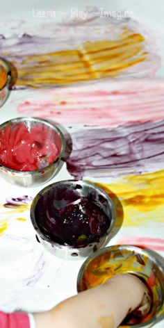 Recipe for homemade finger paints.  I love the vibrant colors and scents produced by the secret ingredient.  So much fun!