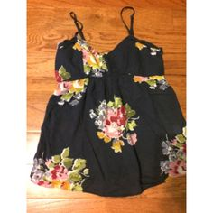 Small navy floral tank top American Eagle tank top. Small. Navy blue and floral. Straps adjust. American Eagle Outfitters Tops Tank Tops