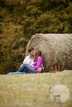 It's official...me and Tyler have to find a field with a hay bale for our engagement pictures.