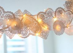 Pennant of doilies and lights