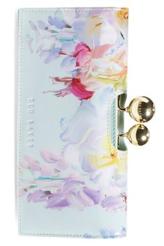 Ring in spring with this adorable wallet from Ted Baker. The gorgeous watercolor print and light colors are absolute perfection.