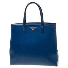 Genuinely created, this Prada bag is a style image. Designed in a particular leather body, it delivers style and class inside equal measures. This enchanting blue piece is placed by two top grips and equipped with a new spacious fabric interior. Contains: Original Dustbag #Pradahandbags #pradahandbagspink #pradahandbagssaffiano #pradahandbagsoutfit #pradahandbagsblue #pradahandbags2018 Prada Tote, Prada Handbags, Leather Crossbody Bag, Leather Backpack, Sacs Design, Prada Saffiano, Nylon Tote, Online Bags, Tote Bag