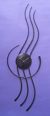 metal wall clock for a modern room in a contemporary style