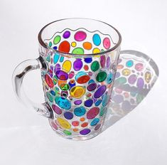 Rainbow Confetti Mug Suncatcher Hand painted Multi Coloured confetti coffee mug Painted Glass cup This is a bright glass coffee mug with hand painted funny confetti in rainbow colors. When this mug is empty it can be a cute, bright and very positive sun catcher :) It can make unique gift