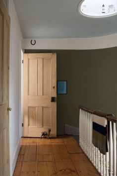 Traditional accents like generous crown molding and a good-luck horseshoe are accented with a wall reminiscent of untouched tree lines. | Tarrytown Green HC-134 (wall), White Diamond OC-61 (trim), Sheer Bliss CSP-545 (ceiling), @benjamin_moore