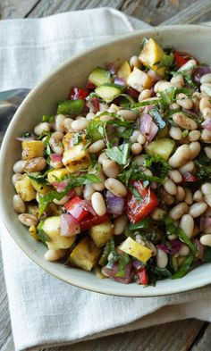 Looking for a delicious side dish? Try this Mediterranean Vegetable and Bean Salad Recipe that is loaded with flavor!
