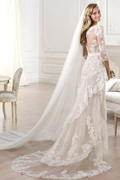 Exquisite tiers of French lace in a mermaid style gown with a sexy front slit…