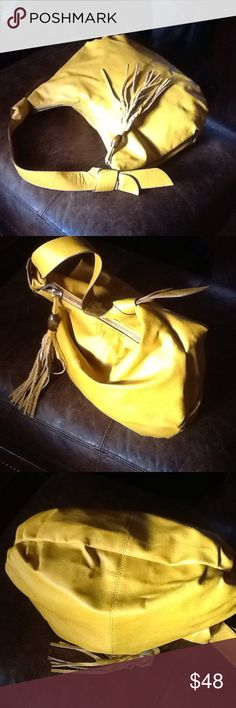 16x12 yellow leather hobo ,tassel,knot bows NWOT 16x12 genuine leather with tassel on zipper pull with wooden bead knotted bows on shoulder strap NWOT beautiful bright yellow leather by THE LIMITED zipper picket inside,also two pockets inside🐣 the LIMITED Bags Hobos