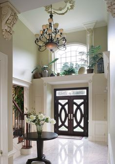 Love the details & ledge above this front door! And the ceiling medallion, corbels, trim around door openings... - Interior Details | Creative Design Construction & Remodeling