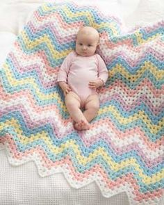 "Crochet this zig-zag blanket in the rainbow colors of Bernat Giggles.  Approx 40"" x 42"" [101.5 x 107 cm].  MATERIALS: Bernat Giggles (100 g/3.5 oz; 169 m/185 yds) 1ball ea:  Contrast A (Oh Sunny Day), B (Giggling Green),C (Laughing Lavender),   D (Cheerful Blue),E (Tickled Pink)  Contrast F (White) 2 balls, Size H/8/5mm crochet hook   free pdf"