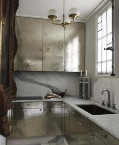 Kitchens that utilize mirrors for an unexpected twist.