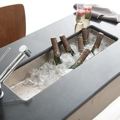 Rio Chico trough sink is a favorite as a bar or prep sink. Artisan crafted hammered copper with a graded transition, its sleek and compact design is made for easy clean up.