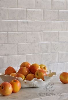 Giovanni Barbieri Lucido inch bricks shown in Bianco Carrara tile by New Ravenna Mosaics.