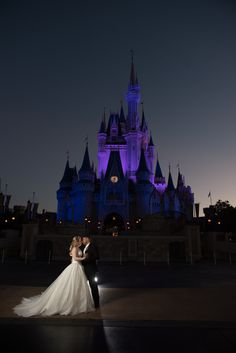 Cinderella Castle glowing purple in the very morning hours at Magic Kingdom. Photo: Stephanie, Disney Fine Art Photography