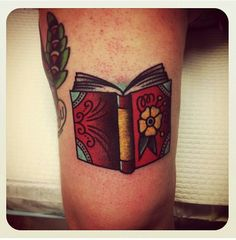 Traditional style book tattoo.