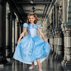Whether your little princess fell in love with Ella from the 2015 live-action remake or has been a staunch fan of Cinderella since you first introduced her to the classic animated film, your daughter will adore this Disney Cinderella Movie Deluxe Costume for Kids.  With a gorgeous front bodice that shimmers in the light, pretty butterfly accents and a skirt that sparkles all around, this costume will make your princess feel like she's the center of attention no matter the occasion.