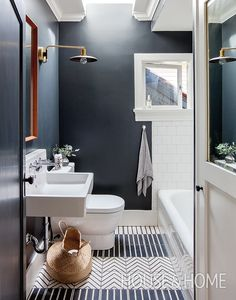 Designer Sophie Burke created a custom pattern with black and white Moroccan floor tiles, then painted the walls black for a little drama. | Photographer: Janis Nicolay