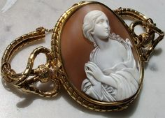 """Saint Mary Magdalene--Material: Sardonyx Shell, 18K gold tested .   Size:   2 1/2"""" by  2"""" only cameo is 2 1/8"""" by 1 6/8"""".   Date and Origin: Ca 1850, Italy, frame is English.   Conditions: A very few slight and short natural shell lines not visible from the front or the back, barely visible when cameo is backlit, mentioned for accuracy otherwise mint."""