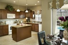 Monaco model home has  kitchen with island and breakfast nook.
