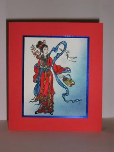 handmade card ... Asian theme ... red background ... beautifully colored girl in traditional clothing ... luv the sparkle on the ribbons and the shimmer of the blue foil mat ...