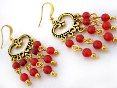 Poppy Earrings $14.00 Ladies beaded chandelier earrings. Frosted glass beads, gold plated Tibet silver on gold plated wire.