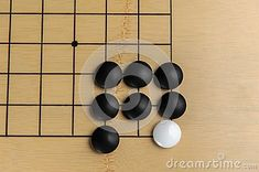 Photo about arrangement of pawns on the game board. white blocked by black. Image of japan, player, leisure - 119037826 Go Game, Board Games, Japan, Stock Photos, Stone, Image, Black, Rock, Tabletop Games